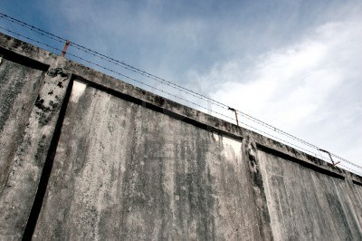 11817865-the-prison-walls-with-high-walls-and-barbed-iron-wire